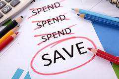 Savings plan checklist, save money. The word Save circled in red below a list of spending surrounded by pencils, graphs, books and calculator Stock Photos