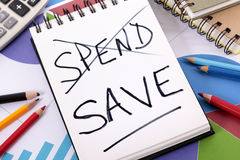 Spending and saving message Royalty Free Stock Photos