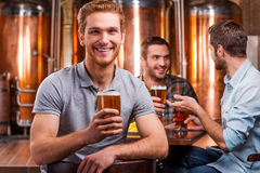 Spending time in beer pub. Stock Photo