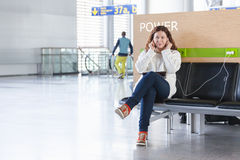 Spending time and charging devices in airport Royalty Free Stock Photos
