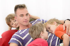 Spending time with family. Father playing with kids at home royalty free stock photography