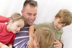 Spending time with family. Father playing with kids at home stock images
