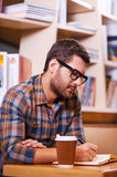 Spending time in library. Royalty Free Stock Photography