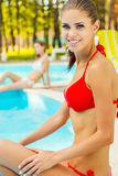 Spending time by the pool. Royalty Free Stock Image