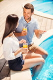 Spending time poolside together. Royalty Free Stock Photo