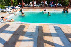 Spending time in swimming pool Stock Images