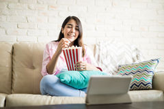 Spending time watching movies Stock Images