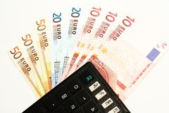 Spending Wisely. Euro Currency Notes with a Calculator as a Reminder to Spend Wisely Stock Photography