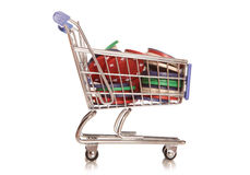 Spending your winnings. Shopping trolley with poker chips cutout Royalty Free Stock Photography