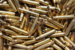 Spent ammo cases. Fired, rifle, ammo, cases ,shot, shoot, shooting, gun, target, brass, empty, dead, death, kill, killed, killing Royalty Free Stock Photography