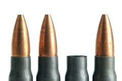 Spent rifle Bullet. Bullet casing between unfired bullets Royalty Free Stock Images