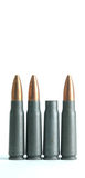 Spent rifle casing. Bullet casing between unfired bullets Stock Image