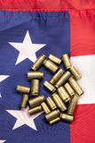 Spent shells on the stars and stripes. A concept image of shell casings and an American flag Stock Photography
