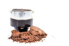 Spent or used coffee grounds with portafilter at the background Royalty Free Stock Images