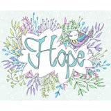 Speranza ispiratrice di frase incorniciata dai fiori Fotografie Stock