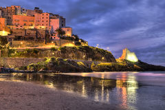 Sperlonga  italian fishing village view from the beach at dawn Royalty Free Stock Image