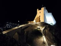 Sperlonga - Truglia Tower from the village. Sperlonga, Latina, Lazio, Italy - September 9, 2017: Truglia Tower night view from the historic center of the village Stock Photography