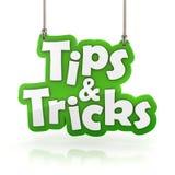 Spetsar och trick gör grön att hänga för textsymbol som isoleras på vit Royaltyfria Foton
