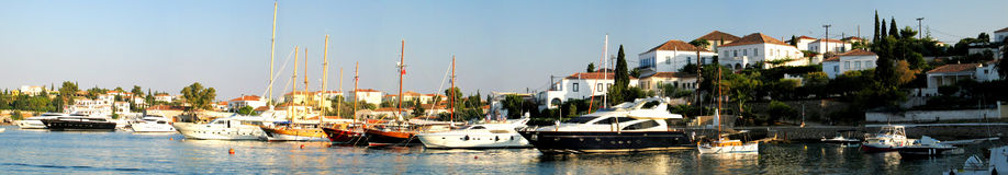 Spetses Old Harbour Panoramic. A panoramic shot of the old harbour of Spetses island, Greece royalty free stock images