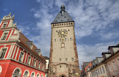 Speyer Clocktower, Germany. Clocktower and red house in the historical center of the city of Speyer in Germany Stock Photography