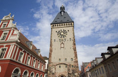 Speyer Clocktower, Germany. Clocktower and red house in the historical center of the city of Speyer in Germany Royalty Free Stock Photo