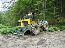 Spezielle Forstwirtschaftstraktoren Stockbilder