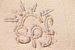 SPF handwritten on sand on a Barbados beach Royalty Free Stock Photos