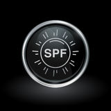 SPF sun health icon inside round silver and black emblem. Sun protection factor symbol with SPF sunblock icon inside round chrome silver and black button emblem Stock Photos