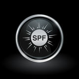 SPF sun health icon inside round silver and black emblem. Sun protection factor symbol with SPF sunblock icon inside round chrome silver and black button emblem Royalty Free Stock Photography