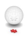 Sphère des puzzles et de l'élément rouge Photographie stock