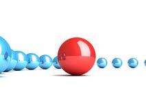 Sphère rouge d'amorce avec les sphères subalternes bleues Photographie stock libre de droits