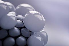 Sphères brillantes aux nuances grises Photos stock