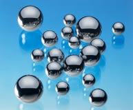 Sphères en acier reflétées Photographie stock