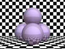 Sphères en verre sur le damier image stock