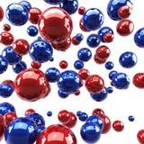 Sphères lustrées rouges et bleues Images stock