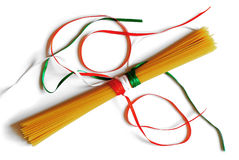 Sphagetti tied with ribbons. Spaghetti tied with ribbons in colours of italian flag on white background Royalty Free Stock Image