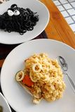 Sphaghetti italiano de las pastas de la tinta del Risotto y del calamar de la comida Fotografía de archivo libre de regalías