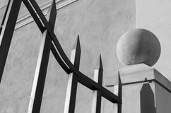 Sphere above the concrete pillar and gate. A sphere above a concrete pillar ang a gate in a black and white image Royalty Free Stock Photography