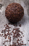 Sphere of coffee and coffee beans on old gray wooden table Royalty Free Stock Photography
