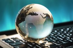 Sphere concept. Gloabal sphere on the keyboard Royalty Free Stock Photos