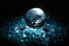 Sphere and crystals. Nice wallpaper with crystal sphere and blue light Royalty Free Stock Photography