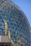 Sphere detail with golden statues Stock Image