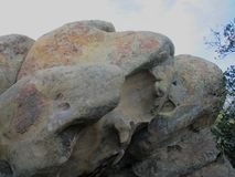 Sphere and egg shaped giant boulders at Lizard`s Mouth trail. Gigantic egg and sphere shaped boulders of sandstone sitting at Lizard`s Mouth Rock, Santa Barbara Royalty Free Stock Photography