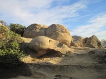Sphere and egg shaped giant boulders at Lizard`s Mouth trail. Gigantic egg and sphere shaped boulders of sandstone sitting at Lizard`s Mouth Rock, Santa Barbara Royalty Free Stock Photos