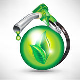 Sphere and gas pump nozzle. Green energy fuel concept with sphere and gas pump nozzle Stock Photos