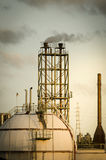Sphere gas storage tank and chimney Stock Photography