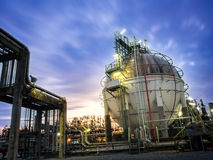 Sphere gas storages in petrochemical plant. With clounds movement Royalty Free Stock Image