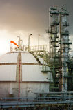 Sphere gas storages in petrochemical plant and column tower back. Sphere gas storages in petrochemical plant column tower background at sunset Royalty Free Stock Photos