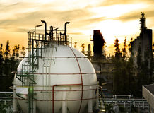 Sphere gas storages in petrochemical plant. At dawn Royalty Free Stock Image