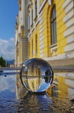 Sphere glass ball. Old palace through the sphere glass ball Royalty Free Stock Photography